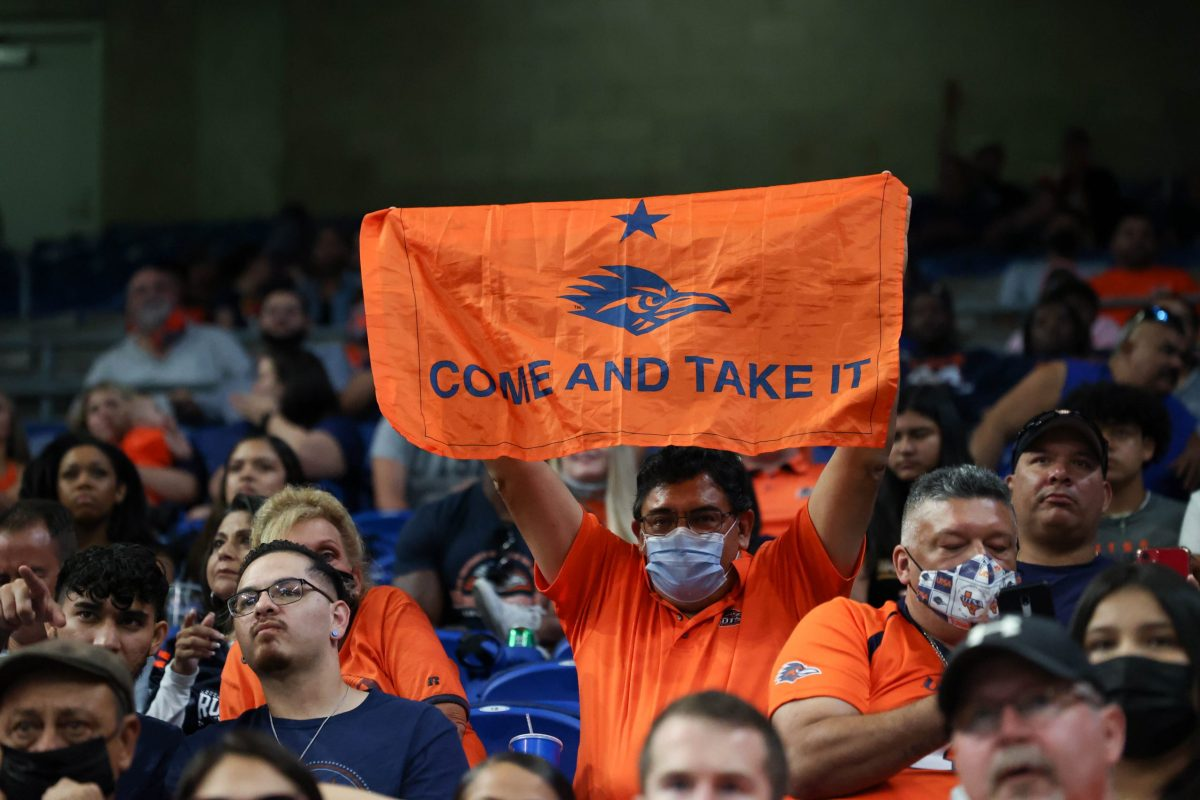 """A fan waves a """"Come and take it"""" flag at the UTSA home opener against Lamar Saturday."""