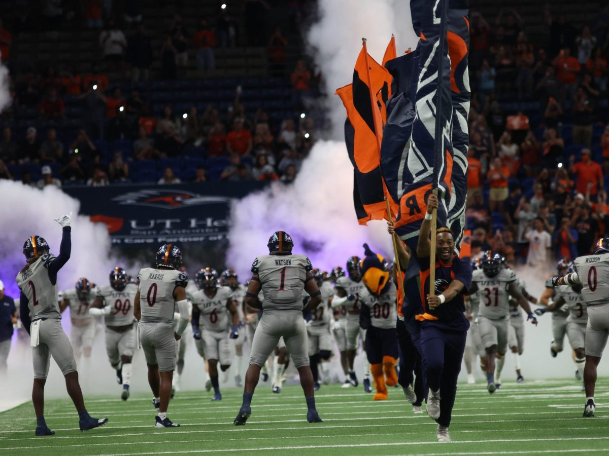 The UTSA football team runs onto the field at the beginning of their home opener against Lamar Saturday.