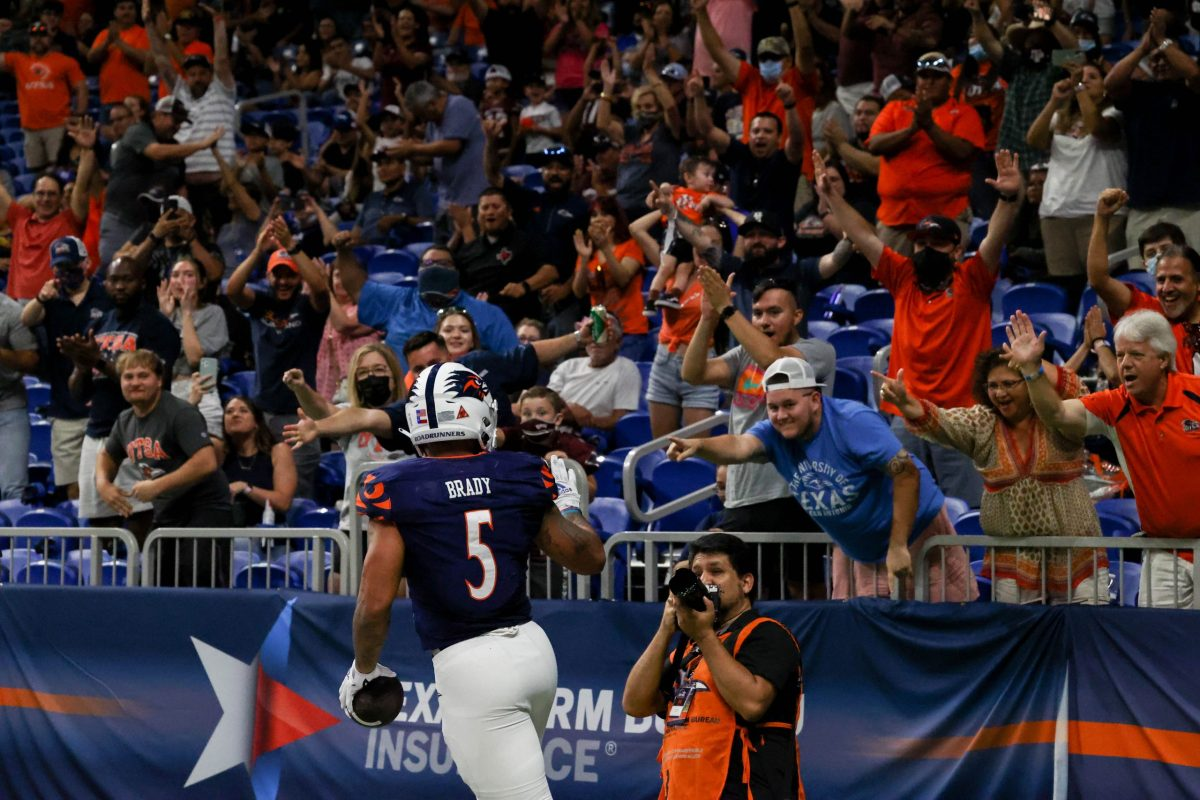 UTSA running back Brenden Brady celebrates a touchdown with fans during the home game against Middle Tennessee Saturday.