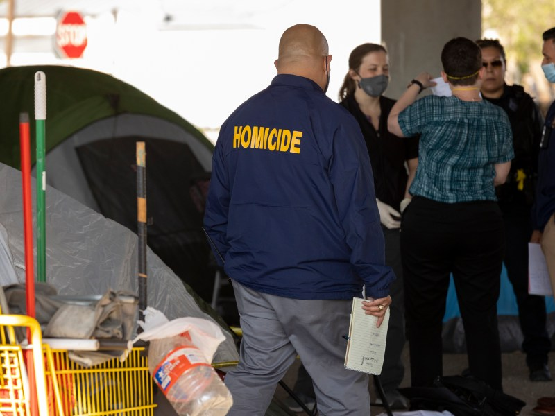 The SAPD Homicide Department investigates a scene at the homeless encampment underneath Highway 281 in March.