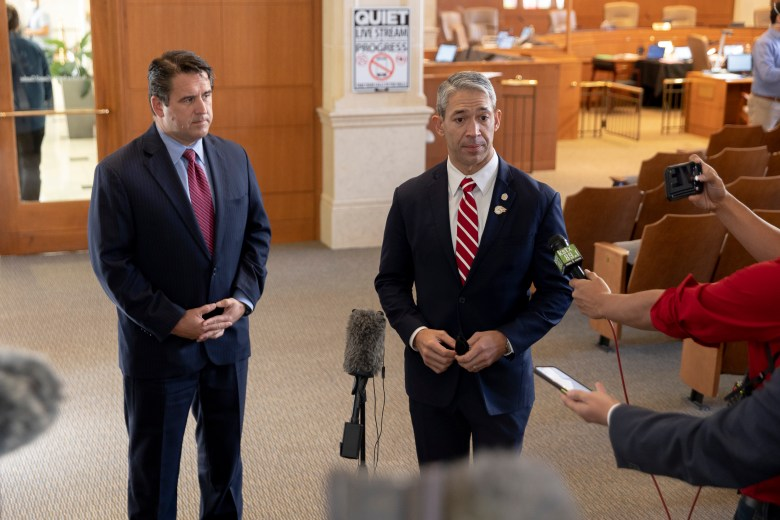 Mayor Ron Nirenberg, right, and City Manager Erik Walsh respond to reporters during a press conference following the passage of the 2022 city budget.