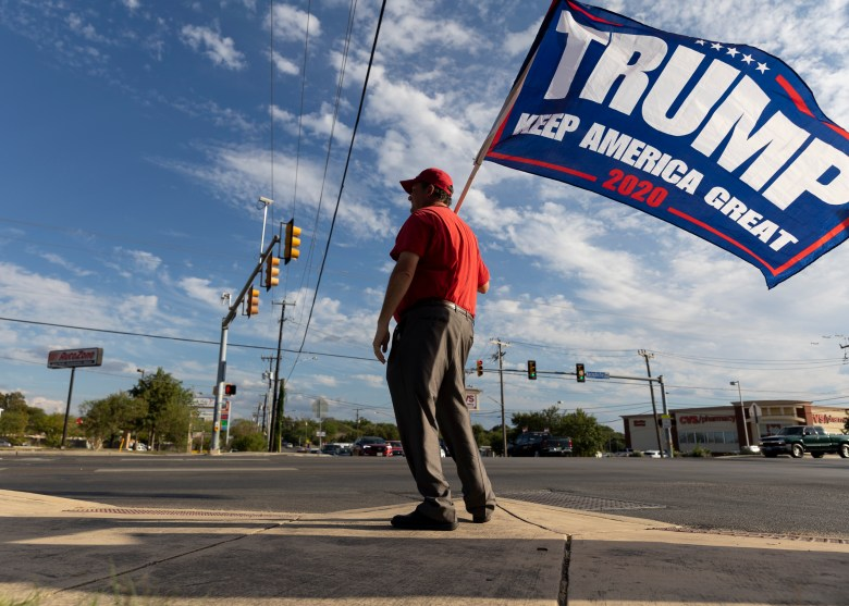 Texas House District 118 candidate Adam Salyer waves a Trump 2020 flag outside of Julia Yates Semmes Library on Monday, September 27, 2021.