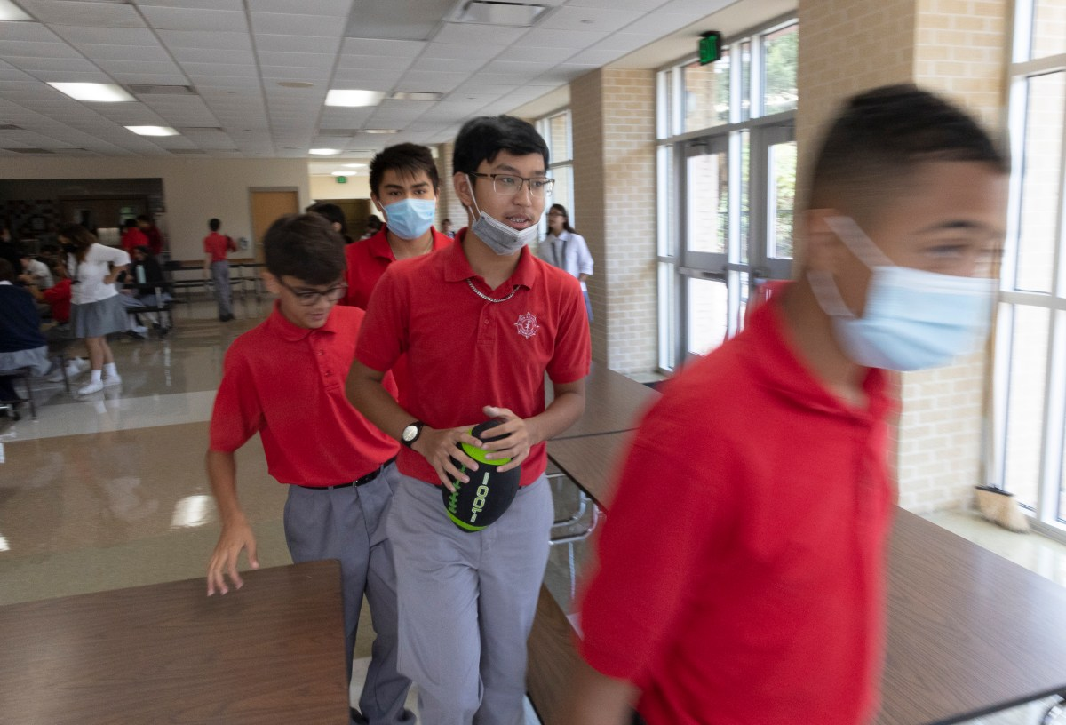 Students at St. Pius X Catholic School file out of the cafeteria after lunch on Thursday.