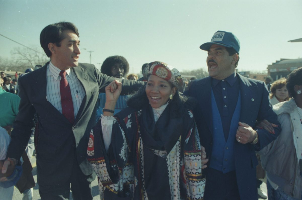 Nomonde Ngubu, organizer of mine workers in South Africa, walks with S.A. Mayor Henry Cisneros (left) and Councilman Joe Webb in the Freedom March, January 16, 1989.