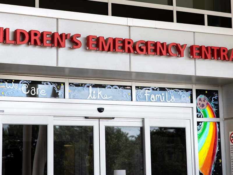 """Methodist Hospital's children's emergency room entrance features artwork and a message reading """"We care like family"""" painted by Hannah Garrison."""