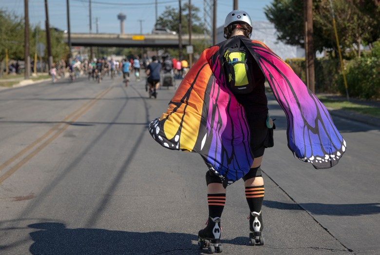 Kristeena Dewberry roller skates with butterfly wings Sunday during Síclovía, the YMCA's biannual event that turns city streets into a safe place for families and friends to exercise and play.