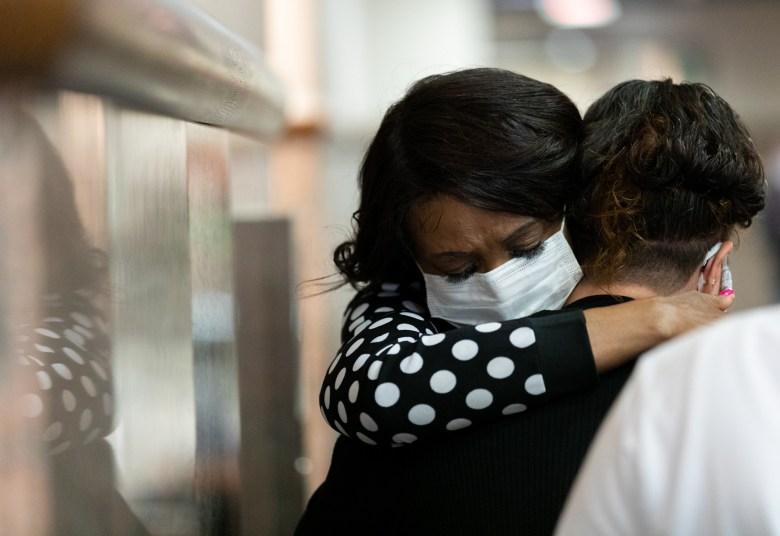 Bernice Bradshaw embraces her stepdaughter Jennifer Dinger following the sentencing of Linda Collier Mason.