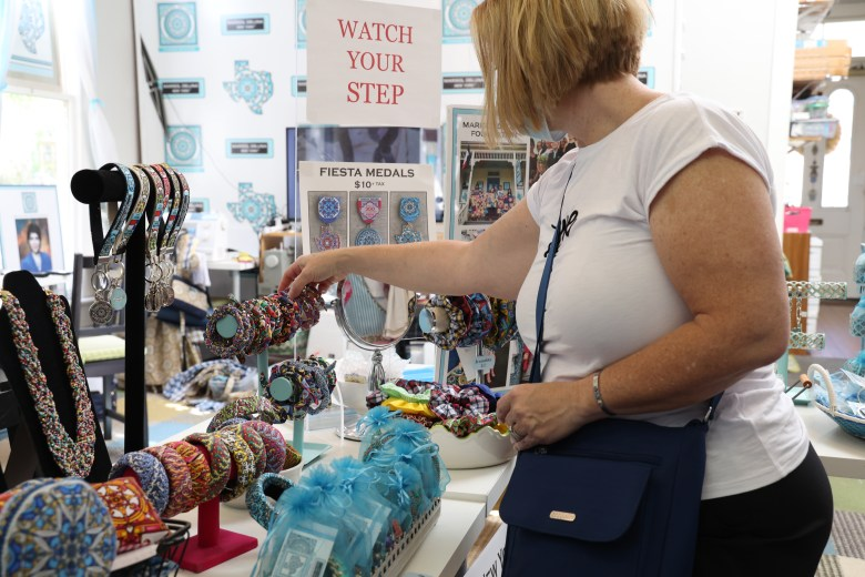 Amy Love-Penfield looks at jewelry inside of Marisol De Luna Foundation Boutique Tuesday.