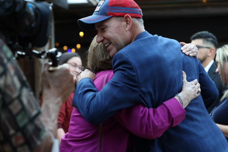 Democratic candidate for Texas Lt. Gov Matthew Dowd hugs an attendee at the meet and greet he hosted at The Friendly Spot Tuesday.