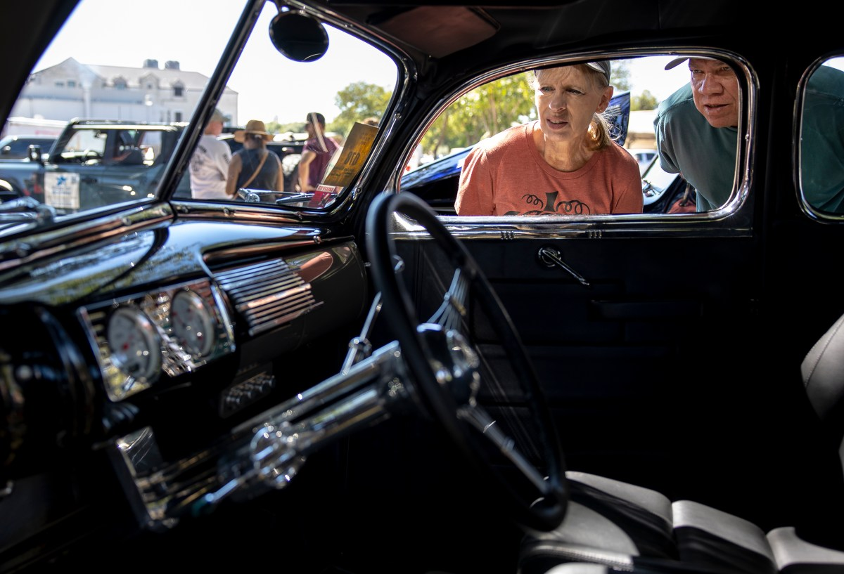 Bud and Pam Slover peer into the interior of a 1940 Ford Coupe during the 35th annual Hills Rod Run car show in Boerne on Saturday.