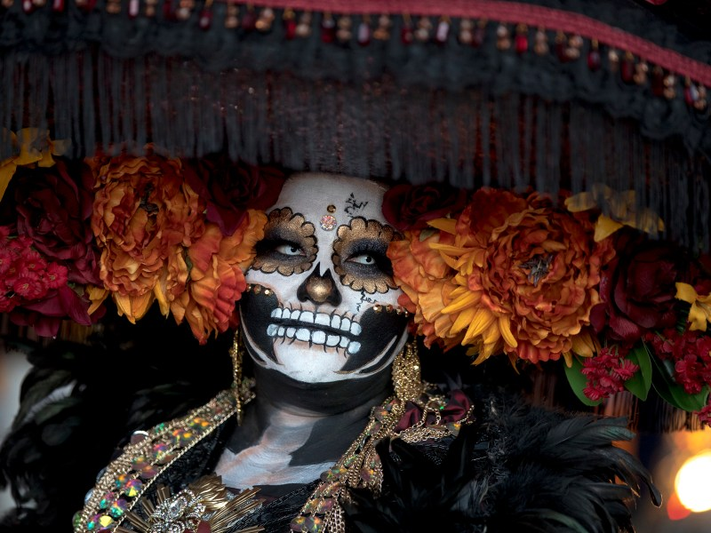 A woman with calavera face paint is seen during Muertos Fest at Hemisfair on Saturday. The two-day cultural event celebrates the lives of lost loved ones.
