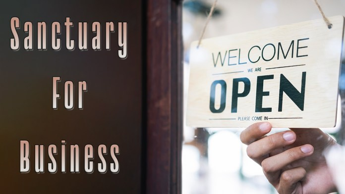 Picture shows a sign indicating the business is open. Text reads - Sanctuary for Business