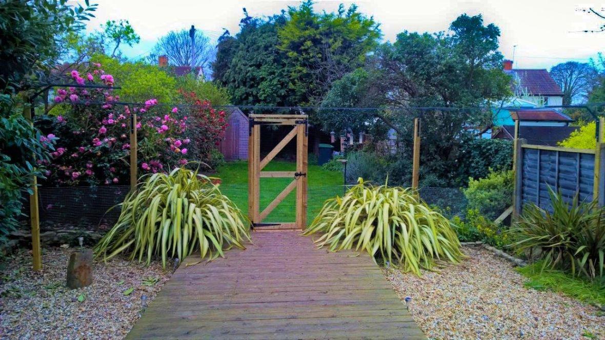 Freestanding cat fence in garden