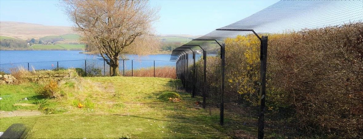 Large outdoor cat run made from Sanctuary SOS cat proof fencing