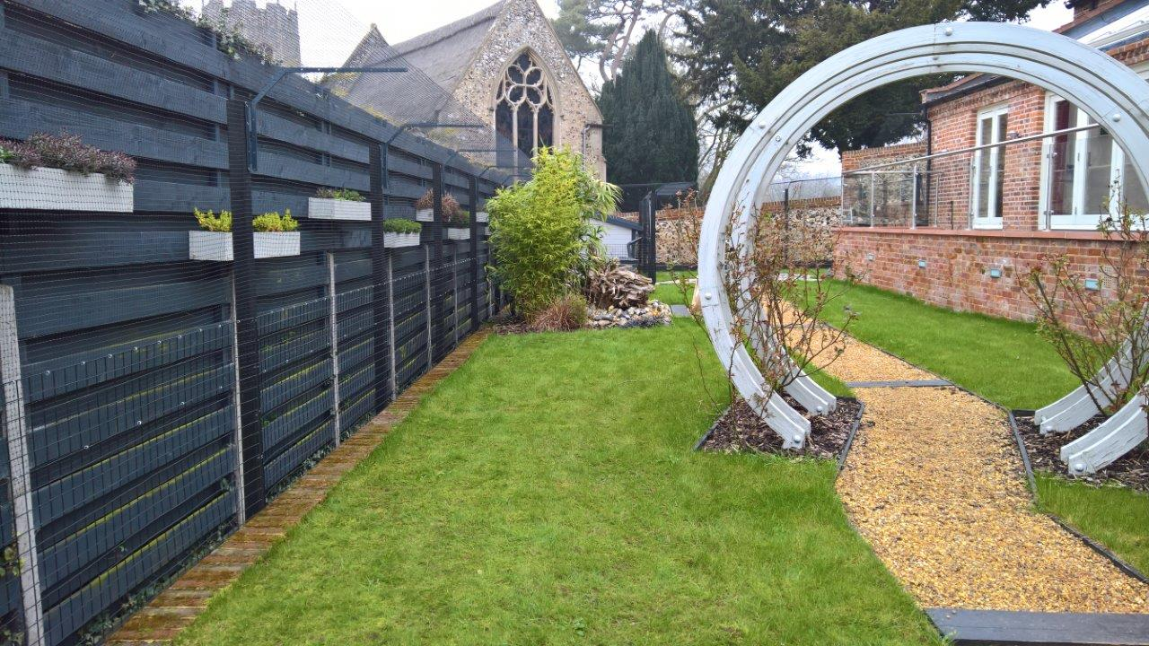 Cat fence barriers fitted to low wall - cat proof garden
