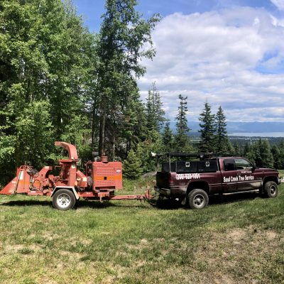 Sand Creek Tree Service's truck and chipper