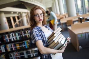Frustrated teen student girl with books