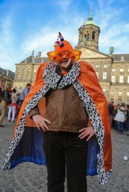 Boyish king poses in front of palace Dutch