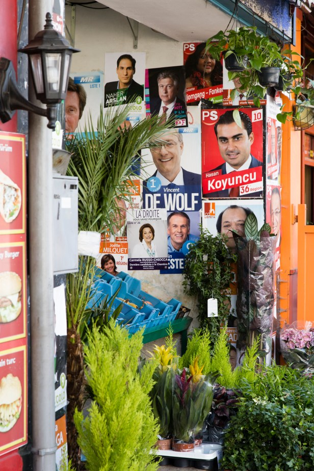 election posters between flowers, plants and cafés