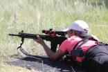 Heidi taking long range rifle shots at the 2019 He-Man