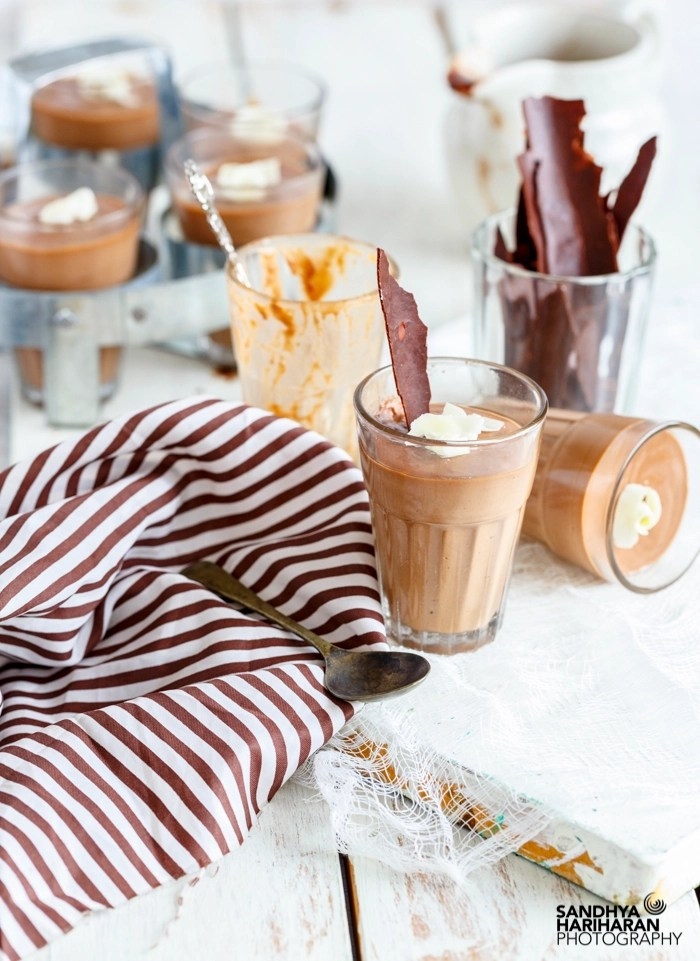 Chocolate Panna Cotta garnished with white chocolate curls served in glasses