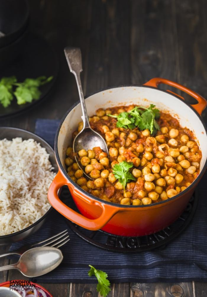 quick and easy chana masala served in orange cast iron along with white rice