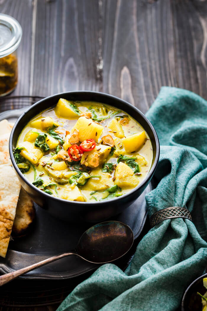 Saag Aloo on a wooden background