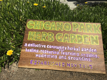 Hand-lettered sign for Chicano Park Herb Garden