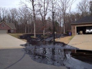 Oil running through a suburban community in Arkansas after a recent pipeline rupture.