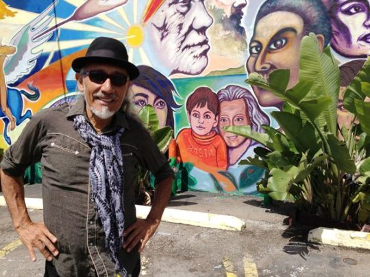 Mario Torero Acevedo in front of the mostly restored mural.