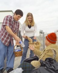 Local church youth helping an OB homeless man.