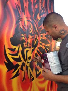 Cesar Castañeda works on his Mictlantecuitli mandala mural.