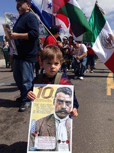 Barrio Logan resident Sandino Beltrán marches for neighborhood children just like himself.