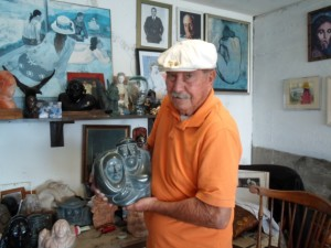 Paul Torres with sculptures