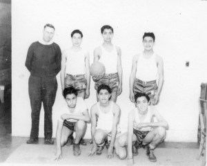 Neighborhood House basketball team with coach Pinkerton, c.1943