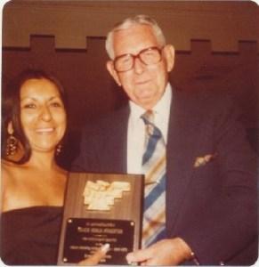 Coach Pinkerton receiving award