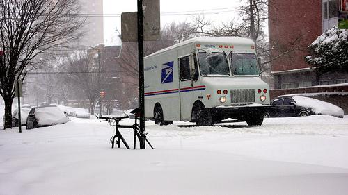 USPS truck in snow