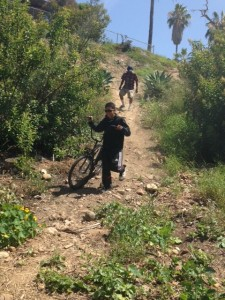 Biker and hiker coming down from 47th and Myrtle trail head