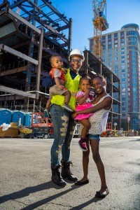 construction worker and her family at downtown construction site