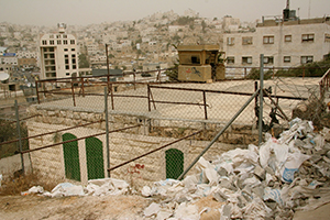 A military observation post on top of a Palestinian home in Hebron.