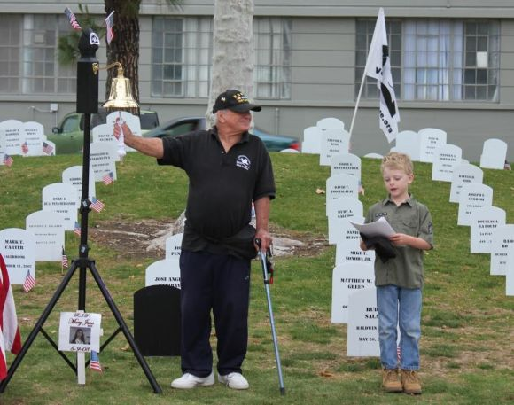 stan levin and young boy standing in front of symbolic military tombstones