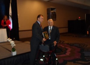 Jesse Ramirez receiving Chicano Federation plaque
