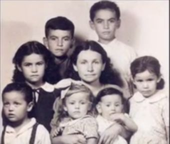 Roger's mother with seven of the ten children
