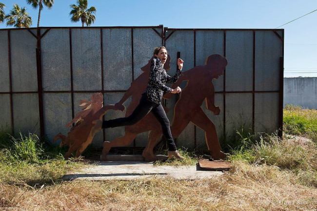Jean Von Borstel, artist in Playas Tijuana, with her iron and wood sculpture in Playas Tijuana, Mexico.