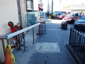 Photo of the railings installed ouside of the OB Brewery that squeezes pedestrians into narrow space.