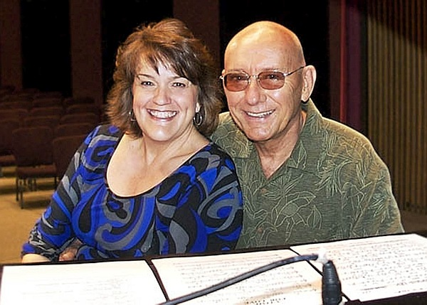 Holly Hofmann and Mike Wofford seated behind a piano