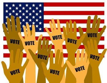 Graphic of raised hands with the word VOTE on the palms, U.S. flag in background