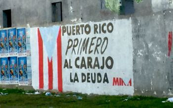 "Graffito in Trujillo Alto: ""Puerto Rico first. To hell with the debt."" Photo: Ed Morales"