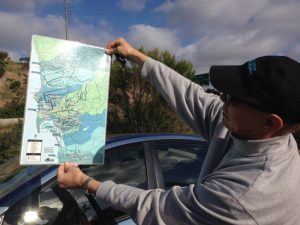 Eric Bowlby displaying a map of the canyon network in San Diego.