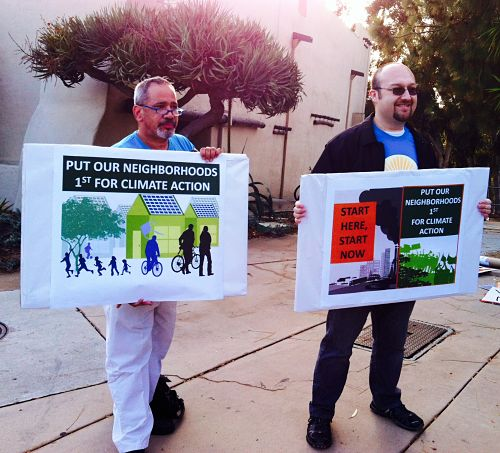 Two Climate Action Plan rally participants with signs